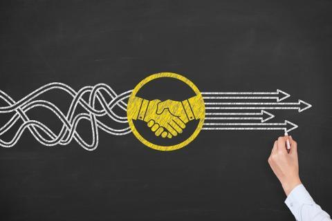 Chalkboard Handshake Concept image